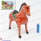 Лошадка на батарейках, ходит, двигает головой и хвостом.