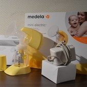 Новый  электрический молокоотсос Medela Mini Electric