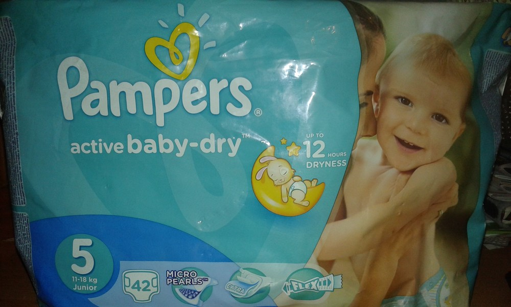 Pampers 5-ка 11 штук фото №1
