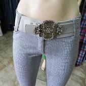 Чудесные новые M,L нарядные стрейчевые штаны