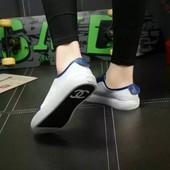 Chanel кроссовки. Логотип, кожа