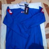 Продам футбрльный костюм Lotto ,рост 164-176 см