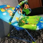 Укачивающий виброшезлонг с дугой с игрушками и музыкой