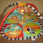 Развивающий коврик с дугами сафари bright starts