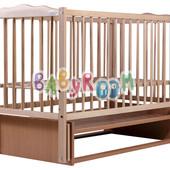 Детская кроватка Дубок Веселка из бука с маятниковым механизмом качания