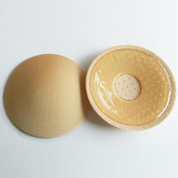 Многоразовые силиконовые наклейки на грудь стикини с тканевым покрытием и перфорацией. фото №1