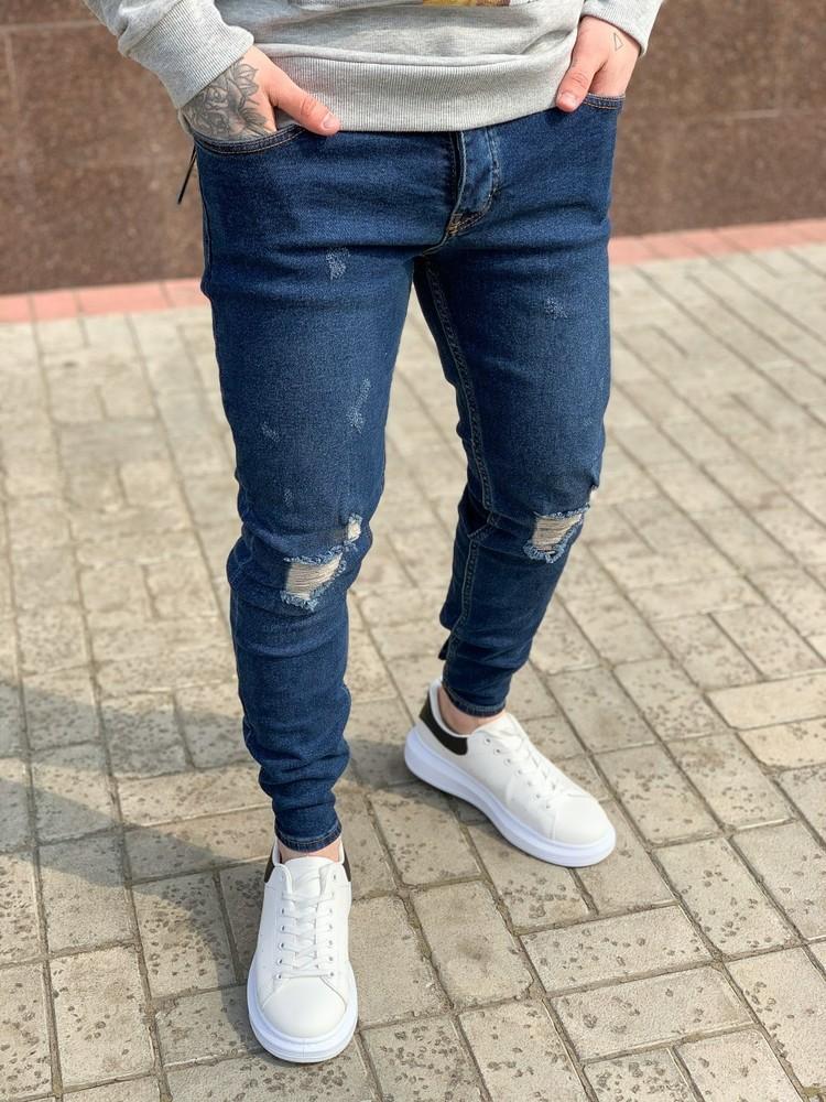 Рваные джинсы фото №1